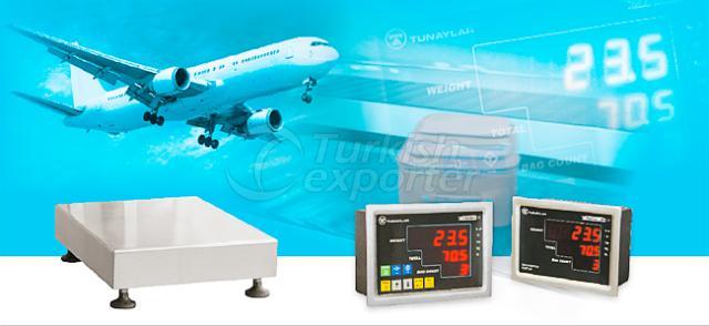 Sistemas de pesagem de bagagem