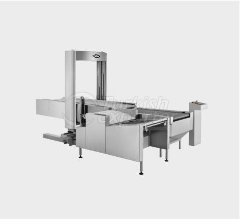 Robot de chargement-déchargement de pain