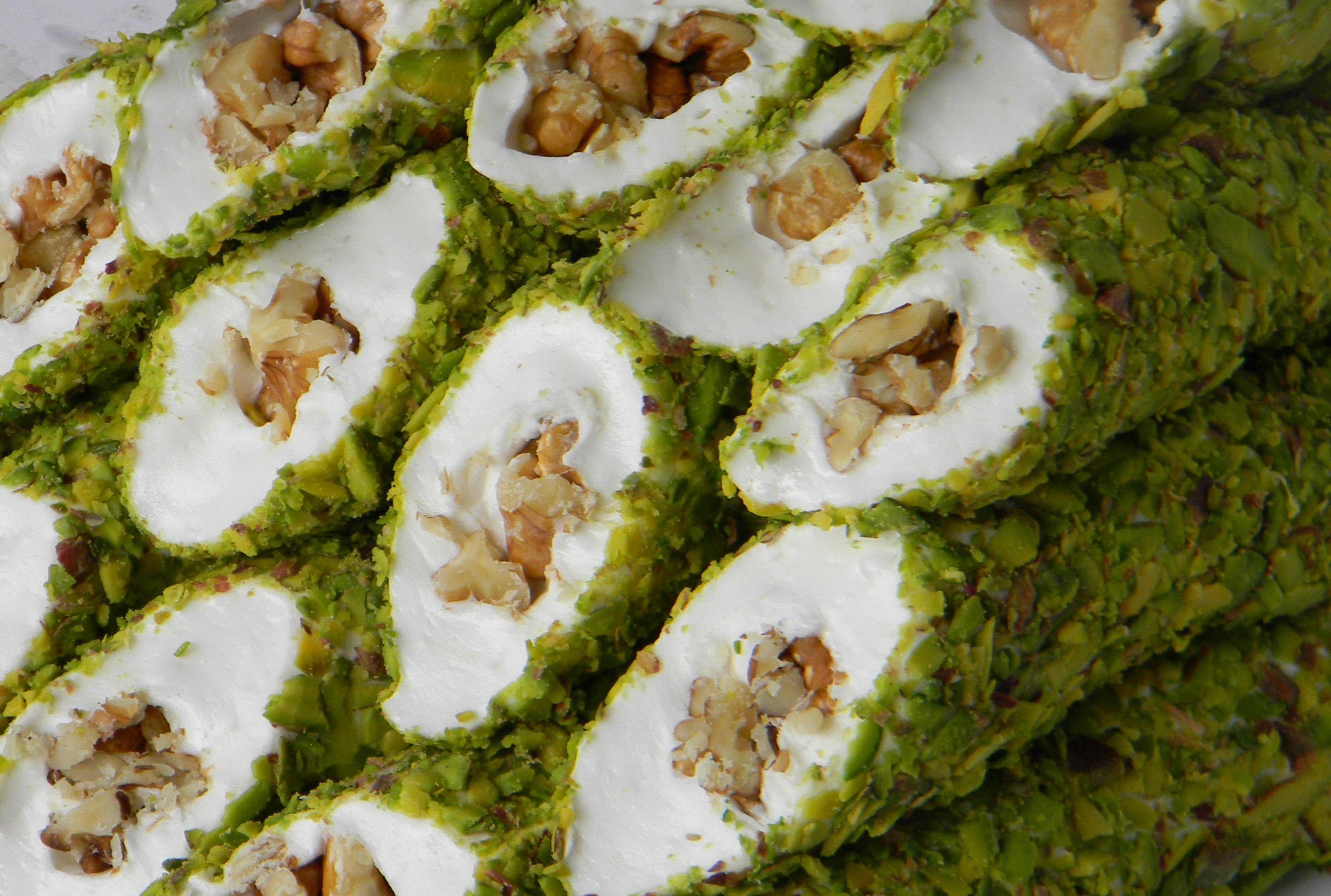 Pistachio Coated Dipped Walnut Delight